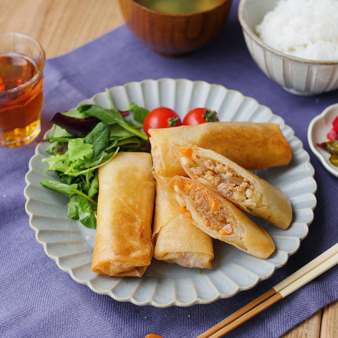 Spring rolls on a gray round plate